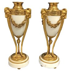Pair of French Louis XVI White Marble and Gilt Bronze Cassolettes With Rams heads
