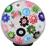 Antique Clichy spaced concentric millefiori with a pink rose glass paperweight.