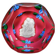 """Saint Louis 1979 """"Amour"""" faceted Cupid sulphide paperweight."""