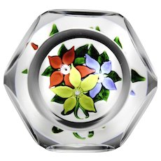 Saint Louis faceted 1971 three-flower bouquet glass paperweight.