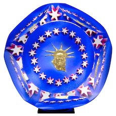 Saint Louis 1986 Statue of Liberty gold inclusion faceted glass paperweight.