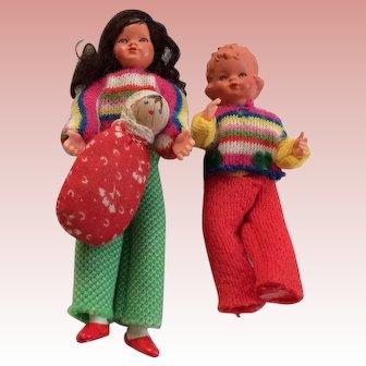Family of three dollhouse babies.  German made.