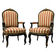 Antique Pair of French Louis XIV Style Ebonized and Ormolu Bergeres, circa 1880