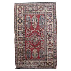 Caucasian Kazak Wool Tribal Rug, Stylized Floral and Foliate Motif, 20th Century