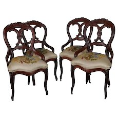 Four Victorian Carved Walnut and Crewel Embroidery Balloon Back Chairs