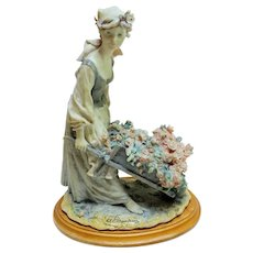 Armini Figurine; Girl With Wheelborrow Filled With Flowers