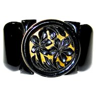 Impressive Black Bakelite Hinge Bracelet with Carved Medallion