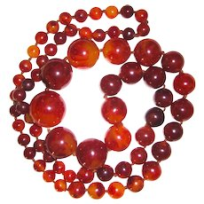 Fantastic Long Red and Caramel  Marbled Graduated Bakelite Bead Necklace