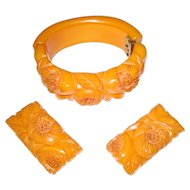 Heavily Carved Butterscotch Bakelite Hinge Bracelet and Matching Clips