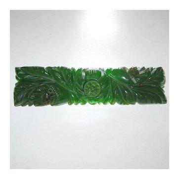 Green Translucent Heavily Carved Bakelite Bar Pin Brooch