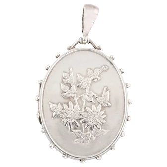 Antique Silver Locket with Repousse Flowers