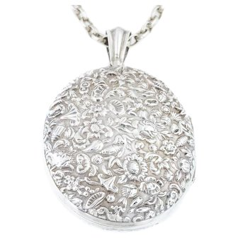 Large Victorian Silver Locket with Shells and Flower Motif