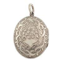 Antique Silver Engraved Oval Locket, c.1882.
