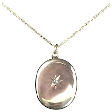 10k Small gold Locket w/ Diamond