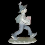 Metzler and Ortloff Figurine of Boy with Concertina, Bird on Head