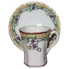Hand Painted Nippon Chocolate Cup and Saucer with Violets, Moriage Trim