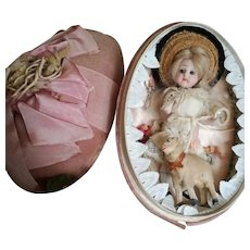Stunning Easter egg presentation box with All Bisque French Mignonette. France, 1890's