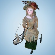 """French Mechanical Toy """"Little Girl Playing Badminton"""" by Vichy, working mechanism, in good condition"""