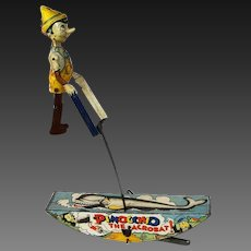 """Very interesting Wind-up toys """"Pinocchio The Acrobat Watch Him Go!"""" . From 1939 -Marx Toy Company-  tin lithograph wind-up toy"""