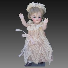 Incredible and very rare Gerdruder Kuhnlenz Tiny doll  ( Mary Janes ) , height 5.5 inches (14 cm), with beautiful antique dress