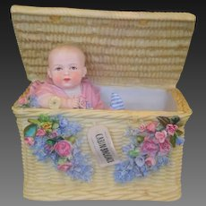 All bisque straw basket with baby