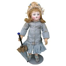 Antique french doll early series of Steiner ,  in antique couturier clothing with spiral blue eyes, high about  13,5 inches ( 35 cm )
