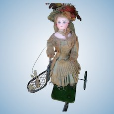 """French Mechanical Toy """"Little Girl Playing Badminton"""" by Vichy, Gaultier head, France 1875"""
