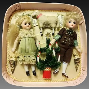 Charming couple of all bisque French Mignonettes in wonderful Christmas presentation box, France 1880s
