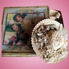 Fashion doll straw hat in original box.  London, circa 1880
