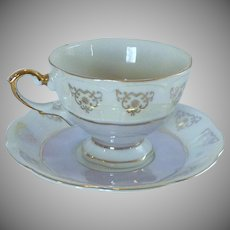 Light Purple Floral Lusterware Gold Trim Tea Cup and Saucer