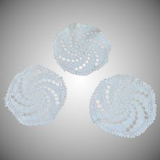 Three White Crocheted Doilies
