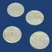 Four Mother of Pearl Machine Carved Buttons