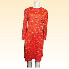 Genie & Lamp Tricot Print on Red Ground......Size Medium