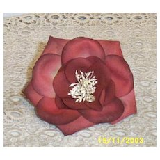 Muted Wine Millinery Flower With A White Straw Center