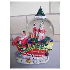 Retired...Green Holly Musical Snowglobe..Radio City Christmas Spectacular