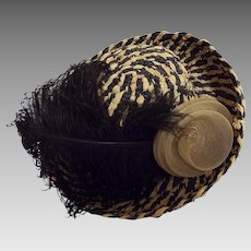 Turned Up Brim Straw Hat In Natural And Navy Woven Straw With Black Feather And Beige Horsehair Round Flower Accent