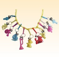 "1980'S Plastic Charm Necklace..Yellow Plastic Chain..Assorted Colored Charms..23"" Long"