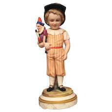 Utterly Charming French Bisque Figurine of Boy Holding Polichinelle