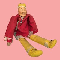 Unusual German Bisque Character Depicting Asian Man with Stylized Comical Features and Amber Tinted Complexion