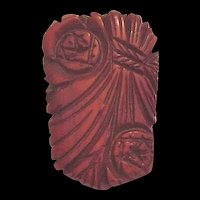 Carved and Pierced Bakelite Dress Clip