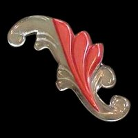 Swirling Clear Lucite and Red Bakelite Pin