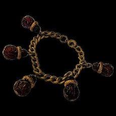 Carved Cherry Amber Bakelite Charm Bracelet