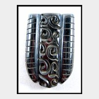 Awesome Carved Black Bakelite Dress Clip
