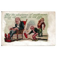 Humorous Postcard of Boys Setting of Fire Cracker Under Old Man's Chair