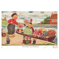 Postcard of Dutch Children with Flowers and Boat in a Canal