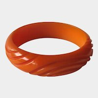 Bakelite Deeply Carved Bracelet Pumpkin or Carmel Color