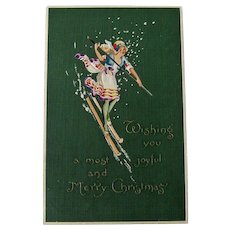 Art Deco Christmas Postcard - Lovely Lady Postcard - Skiing Postcard