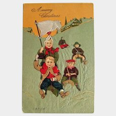 Children on Sleds Postcard - Merry Christmas Postcard