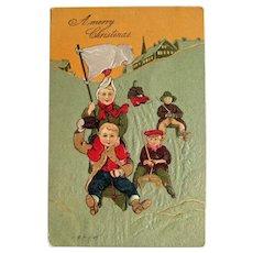 Children on Sleds Postcard - Merry Christmas Postcard