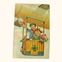 New Year Postcard / Children in Basket / Hot Air Balloon / Vintage Ephemera